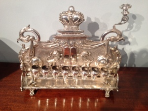 A mystery menorah, believed to have been made in Eastern Europe over a century ago, no one seems to know when it got here or how it got from there to here. (danielsteinantiques .com)
